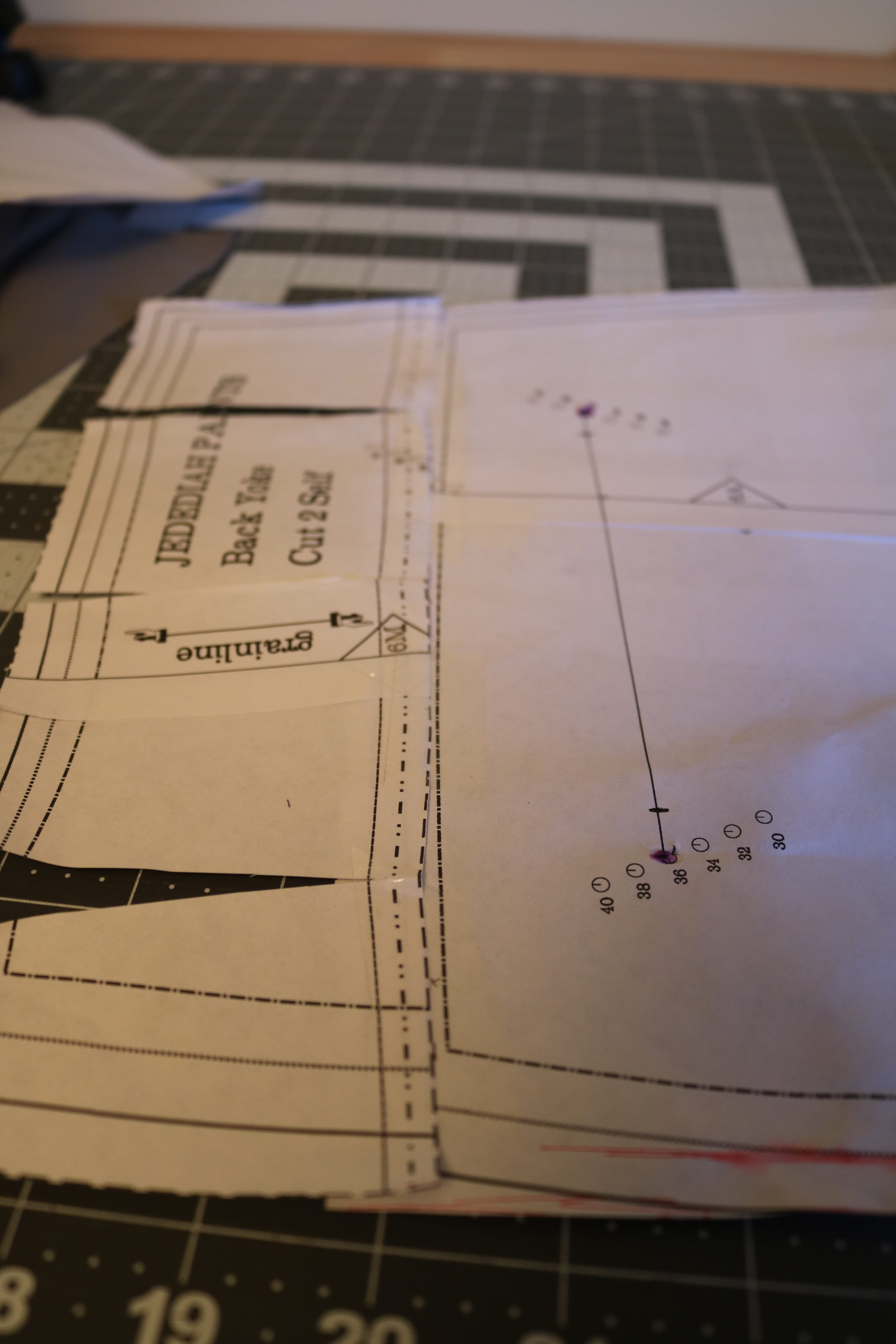 """The first step to this was altering the pattern pieces. Attach the back yoke to the back pants piece overlapping the seam allowance (5/8"""") and cutting into the top of the back yoke piece so it can lay flat."""